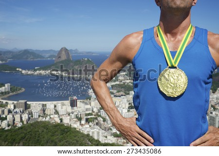 Gold medal champion athlete standing outdoors at Rio de Janeiro Skyline - stock photo