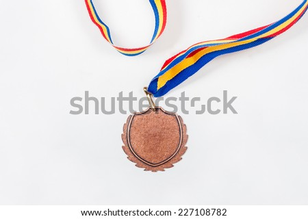 Gold medal isolated on white with blank face for text, concept for winning or success - stock photo