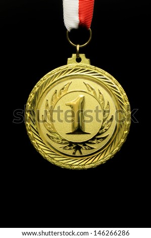 Gold medal winner, trophy champion, black background - stock photo
