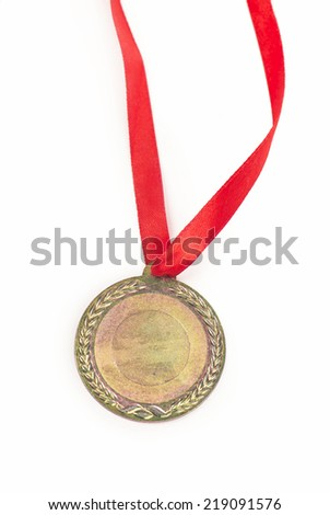 Gold medal with a red tape isolated on white  - stock photo