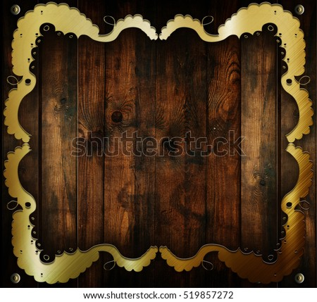 Gold metal frame ornament on wooden plate. Medieval background. Celtic style template