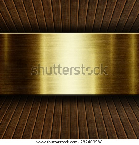 Gold metal plate on  wooden background for design - stock photo