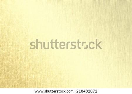 Gold metallic background, linen texture, bright festive background - stock photo