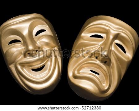 Gold metallic comedy and tragedy masks on black - stock photo