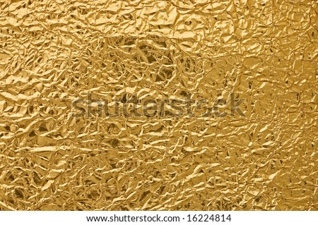Gold metallic crumpled paper texture for background. - stock photo