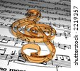 Gold music symbol & Music sheet - stock photo