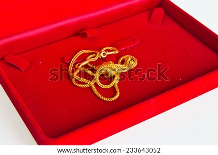 gold necklace in red box - stock photo