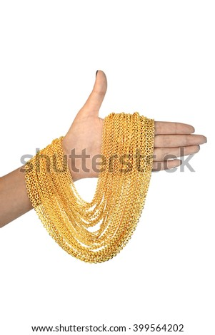 gold necklace on hand - stock photo
