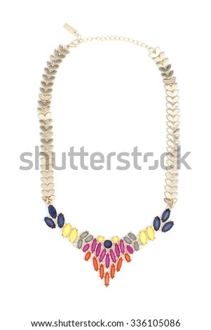 gold necklace with colored stones isolated on white