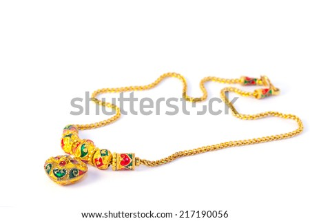 Gold necklace with heart pendants on white background. - stock photo