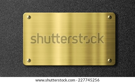 gold or brass sign metal plate over black background - stock photo