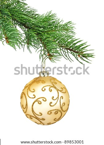 Gold ornament christmas ball in a fir tree on a white background - stock photo