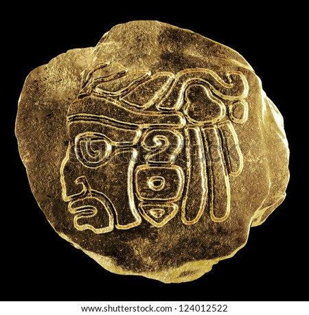 Gold ornament depicting the head of an Indian - stock photo