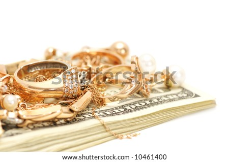 Gold ornaments and dollars isolated on a white background. - stock photo