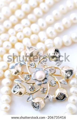Gold ornaments on pearl necklace