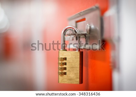 Gold padlock with code to secure storage - stock photo