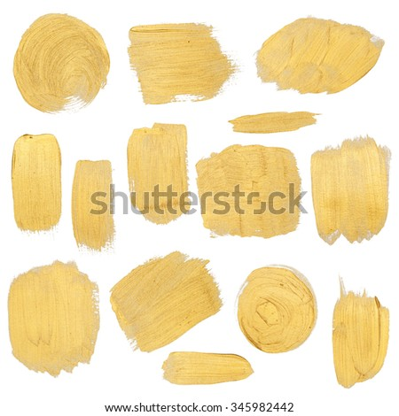 Gold paint stokes set isolated on white background - stock photo