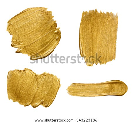 Gold paint strokes isolated on white background - stock photo