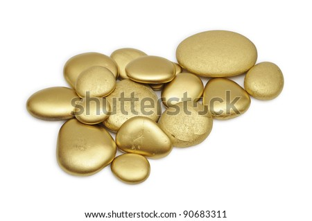 Gold painted stones set over white background. - stock photo