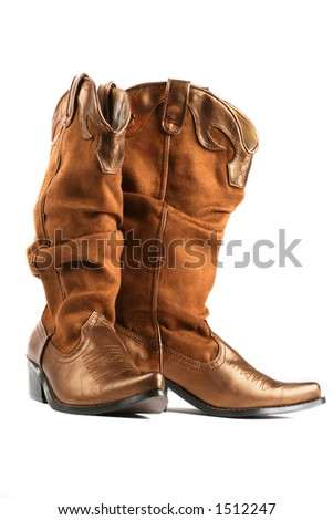 gold pair of cowgirl boots - stock photo