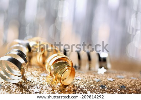 Gold paper ribbon on festive background - stock photo