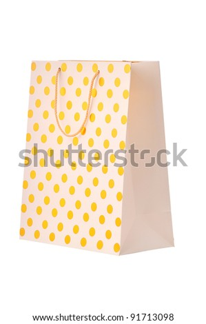 Gold paper shopping bag - stock photo
