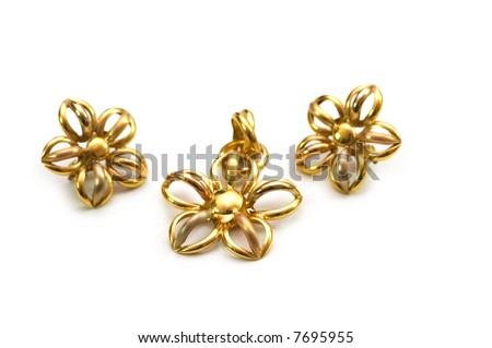 Gold pendant and earrings isolated on the white - stock photo