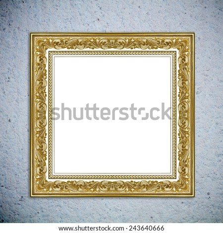 Gold picture frame on the wall - stock photo