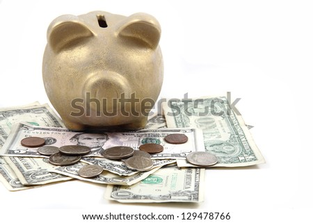 gold pig bank and dollars isolated on the white background