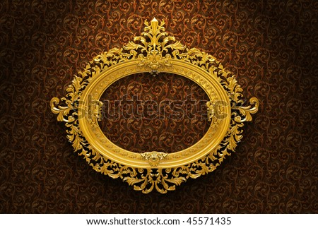Gold plated and richly decorated frame on a wall - stock photo