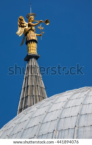 Gold plated statue of an angel on top of the Basilica of Saint Anthony of Padua built in 1310 in Padua, Italy - stock photo