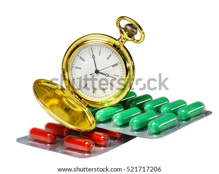 gold pocket watch lying on two plates of tablets. A photo