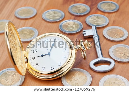 Gold pocket watch on the background euro coins and keys. - stock photo