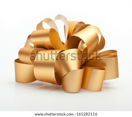 Gold ribbon bow on white background. - stock photo