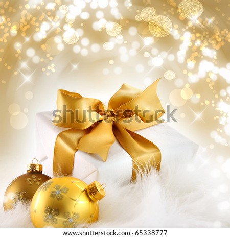 Gold ribbon  gift with festive holiday background - stock photo