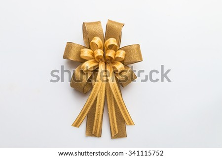 Gold ribbon with bow on white background for christmas and new year - stock photo