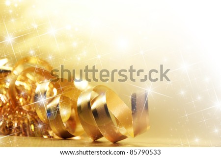 Gold ribbon with shiny stars - stock photo