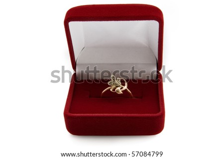 Gold  ring in a jewelry box on white background
