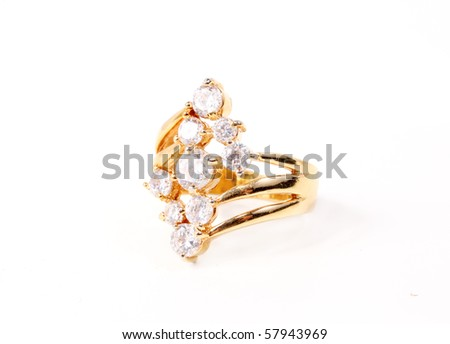 Gold ring with clear stones on white - stock photo