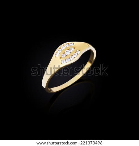 Gold ring with diamond on black background  - stock photo
