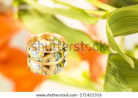 gold ring with enamel - stock photo