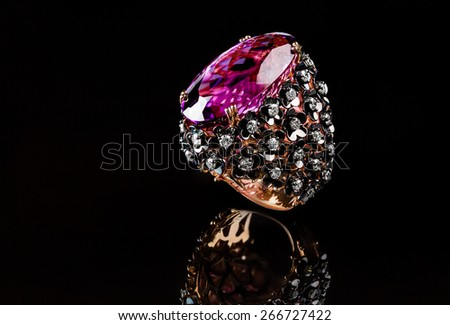 Gold ring with pink amethyst and pave of white diamonds designed as flowers on the side - stock photo