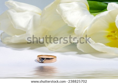 Gold ring with tulip. Gift. - stock photo