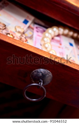 Gold rings euro pearls in a open drower - stock photo