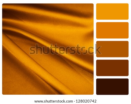 gold satin color palette with complimentary swatches. - stock photo