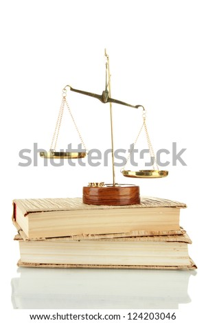 Gold scales of justice and books isolated on white - stock photo