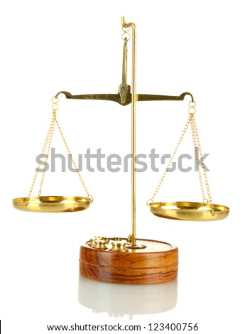 Gold scales of justice isolated on white - stock photo