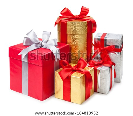 Gold, silver and red gift boxes on white background  - stock photo