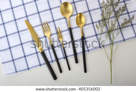 Gold stainless steel knife and fork - stock photo