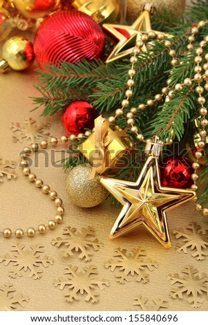 Gold star and Christmas decorations on a spruce branch